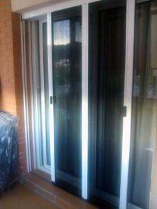 Mosquiteras enrollables en ventanas